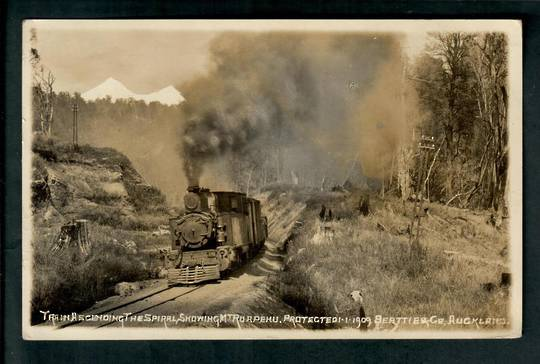 Real Photograph by W Beattie of Train ascending the Raurimu Spiral showing Mt Ruapehu. - 40672 - Postcard