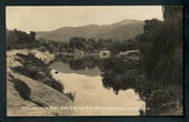 Real Photograph by McDougall 13/2/10. Reflections in the River above Te Reinga Falls Wairoa. Rare card. - 47910 - Postcard