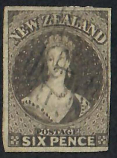 NEW ZEALAND 1855 Full Face Queen 6d Black-Brown.  Imperf. Appears to have roulettes at top. Almost 4 complete margins-just touch