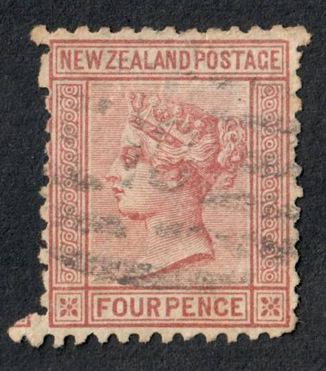 NEW ZEALAND 1874 Victoria 1st First Sideface 4d Indian Red. Perf 10x12½. The pers are not perfect. - 79532 - Used