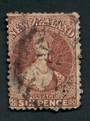 NEW ZEALAND 1862 Full Face Queen 6d Brown. Spacefiller. Perfs okay. Not torn. The postmark is unattractive. Cat val by CP with f