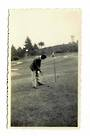 Small Photograph of Golfer putting. With the flag in??? - 41502 - Photograph