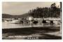 Real Photograph by T G Palmer & Son of Mansion House Bay Kawau Island. Wharf and Launches up close. - 44794 - Postcard