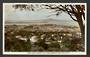 Coloured Real Photograph by A B Hurst & Son. Looking towards Rangitoto from Mt Eden. - 45486 - Postcard