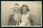 Real Photograph of Young Girl with Santa. - 48474 - Postcard