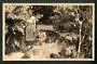 Real Photograph of Maori Girl on the bank of a stream Rotorua. - 49572 - Postcard