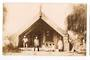 Real Photograph of Maori Whare and Inhabitants Rotorua. Signed by Guide Ella. - 69629 - Postcard