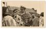 Real Photograph of Captain Parker USA fleet) saluting (hongi) a Maori Girl at Rotorua. - 69653 - Photograph