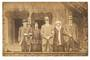 Real Photograph of three tourist and two guides in front of a meeting house. - 69672 - Postcard